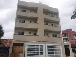 Apartamento 02 quartos, sacada com churrasqueira e garagem coberta