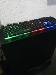teclado gamer usado + teclado convencional