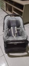 Bebê conforto Burigotto com base.