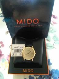 Vendo ou troco um relógio de ouro 18 k modelo 750 unissex! Marca (MIDO)