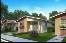 Casa em condomínio fechado após a ponte/2 qrts/entrada a partir de mil/ITBI e Registro