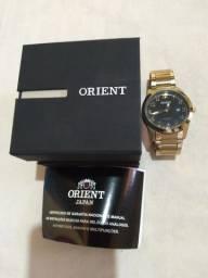 Vendo relógio orient de ótima qualidade a prova d'água , passo cartão