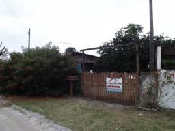 Terreno com casa próximo ao centro de Matinhos