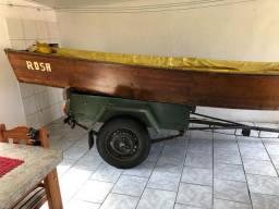 Barco, motor e reboque