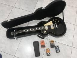 Guitarra leia a discrição
