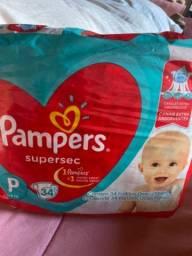 5 pacotes de fraldas Pampers supersec