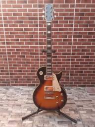 Guitarra Les Paul, acompanha pedestal e capa