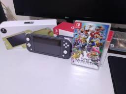 Nintendo Switch Lite Cinza + GripCase e Caps + SD 128Gb + Super Smash Bros Ultimate