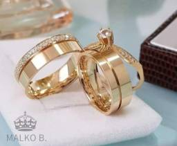 Alianças douradas com garantia