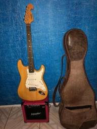 Guitarra + amplificador + capa