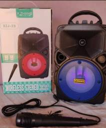 Caixinha de som potente bluetooth com microfone Nova Entregamos