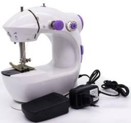 Mini máquina de costura na promoçao