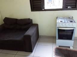 Um pacote sofá e um fogão e uma bicicleta 400 reais
