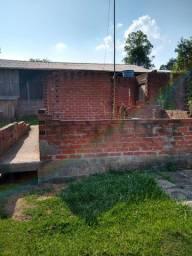 Vendo terreno com casa em construção próx frigonal