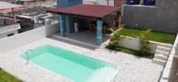 casa caiada com piscina