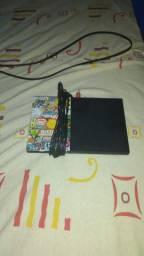 PlayStation 2 usado, bem conservado.