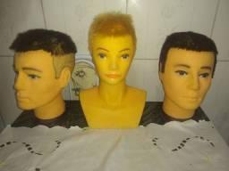 Cabeças de bonecas usadas