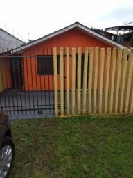 casa pequena no cajuru de frente para rua