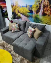 Sofá retrátil dois lugares disponível na cor marrom e cinza