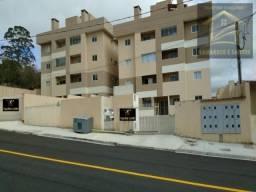 Aluga-se apartamento com sacada e churrasqueira no centro em quatro barras