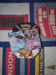 200 cartas pokemon + lata e duas ex de brinde