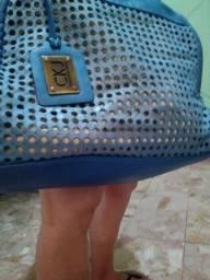 Bolsa da clauvin klain couro azul,usa transversal e de mão,muito linda