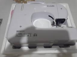 Título do anúncio: Máquina de costura Elgin portátil (,nova)