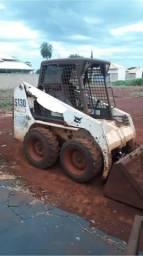 Carregadeira e escavadeira bobcat
