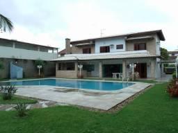 Casa com 6 dorm, sendo 4 suites, piscina em 2 lotes no centro