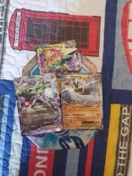 200 cartinhas pokemon + lata , duas ex e um mega ex de brinde