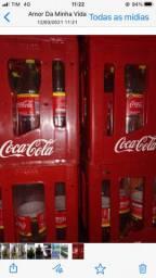 Garrafeira mais garrafas de coca cola