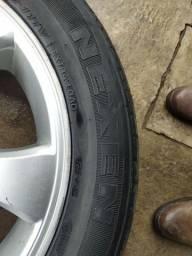 Jogo de roda aro 20 com pneus.