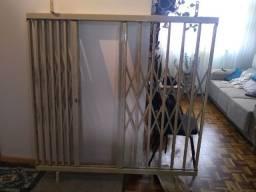 Grade pantográfica de ferro para janela