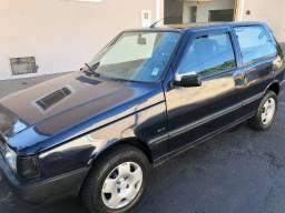 Fiat Uno 1.0 c/ ar condicionado + vidros elétricos - 1995