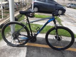 Bike aro 29 freio hidráulico 27v suspensão com trava transbike capacete e buzina