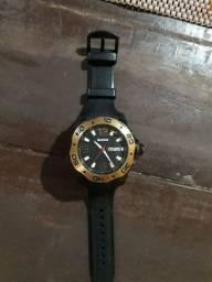 Vendo esse relógio original Magnum semi novo