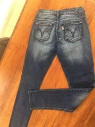 Vendo calça jeans feminina  marca Triton semi-nova