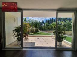 Título do anúncio: Sobrado com 3 suítes, belíssimo quintal, à venda, 506 m² por R$ 0 - Alphaville - Campinas/