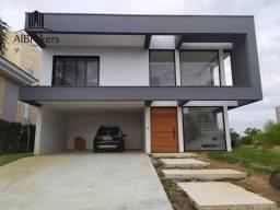 Casa com 4 suítes, 398m² em terreno seco por R$ 3.800.000