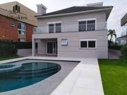 Casa com 5 dormitórios sendo 3 suítes, 395m² em terreno seco por R$ 3.800.000