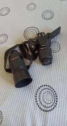 Título do anúncio: Nikon D5100 pouco uso + Lentes Nikkor 18-55mm e 55-300mm Acompanha bolsa para lente e bag