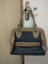 Bolsa de couro azul com bege de couro. Foi comprada na loja Coberluxe.