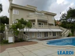Casa de condomínio para alugar com 5 dormitórios cod:458522