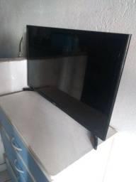 Vendo televisão *Com defeito*