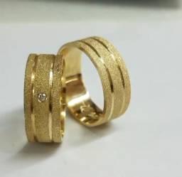 Aliança de ouro 18 quilates com pedra de central de brilhante