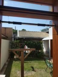 Barra ajustável de exercícios para porta