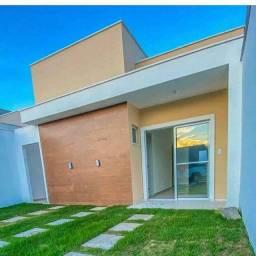 Casa a venda, 2 suítes,  bom condomínio e localização.