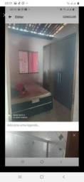Casa com garagem e dois dormitório com